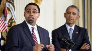Senior Education Department official, John King Jr., left, accompanied by President Barack Obama, speaks in the State Dining Room of the White House in Washington, Friday, Oct. 2, 2015, after Obama announced that Education Secretary Arne Duncan will be stepping down in December after 7 years in the Obama administration. Duncan will be returning to Chicago and Obama has appointed King, to oversee the Education Department. (AP Photo/Andrew Harnik)